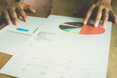 Business team analyze financial numbers. Stock Photography