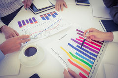 Business team analyzing bar chart graphs Royalty Free Stock Image