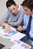 Business team analyzing charts Stock Photos