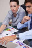 Business team analyzing charts together Stock Image