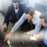 Business team analyzing data on computer. Stock Images
