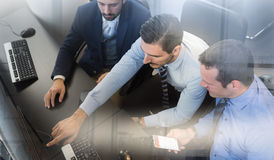 Business team analyzing data on computer. Stock Photography