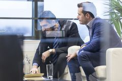 Business team analyzing data at business meeting. Royalty Free Stock Images