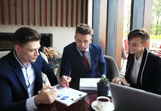 Business team analyzing financial document at meeting. Stock Photo