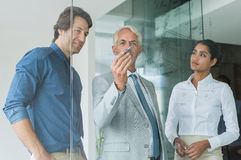 Business team analyzing graph Royalty Free Stock Photos