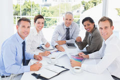 Business team analyzing the graphs Royalty Free Stock Images