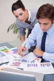 Business team analyzing statistics together Royalty Free Stock Photography