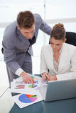 Business team  analyzing survey results Stock Photos