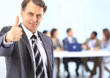 Business Team And A Leader Stock Photos