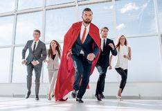 Free Business Team And Their Leader Are Marching In The Office Lobby Royalty Free Stock Image - 129590656