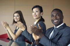 Business team applauding. While at a meeting Royalty Free Stock Image