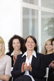 Business team applauding. After a conference in a company royalty free stock photography