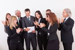 Business Team Applauding. For The Success Of Colleague Stock Image