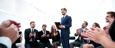 Business team applauding the coach. After the lesson on team building Stock Photos