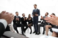 Business team applauding the coach. After the lesson on team building Stock Image