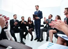 Business team applauding the coach. After the lesson on team building Stock Photo