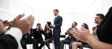Business team applauding the coach. After the lesson on team building Royalty Free Stock Photography