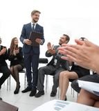 Business team applauding the coach. After the lesson on team building Royalty Free Stock Images