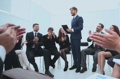 Business team applauding the coach. After the lesson on team building Royalty Free Stock Image