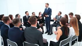 Business team applauding the coach. After the lesson on team building royalty free stock photo