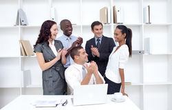 Business team applauding a collegue Stock Photo
