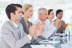 Business team applauding during conference Royalty Free Stock Photos