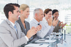 Business team applauding during conference Royalty Free Stock Images
