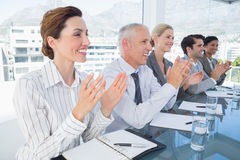 Business team applauding during conference Stock Photos