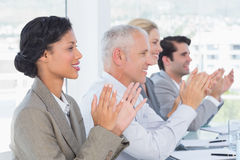 Business team applauding during conference Stock Photography