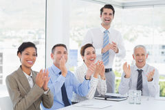 Business team applauding during conference Stock Images