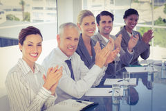 Business team applauding during conference Royalty Free Stock Image