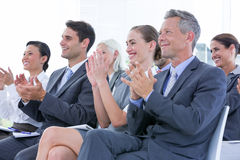 Business team applauding during conference Stock Image