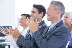 Business team applauding during conference Royalty Free Stock Photography