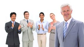 Business team applauding its boss Royalty Free Stock Photography