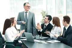 Business team applauding leaders at the meeting. Photo with copy space Stock Images