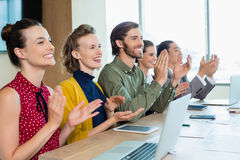 Business team applauding during meeting in conference room. At office Royalty Free Stock Image