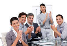 Business team applauding after a presentation
