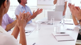 Business team applauding after a presentation stock footage