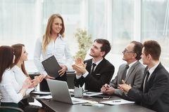 Business team applauding the speaker at the meeting. Photo with copy space stock photo