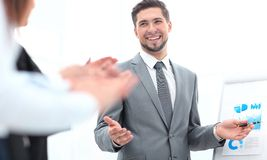 Business team applauding the speaker after the business presentation. The business concept stock photos