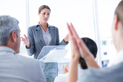 Business team applauding their colleague Stock Photo