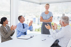 Business team applauding their colleague Royalty Free Stock Images