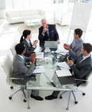 Business team applauding their manager Stock Photo