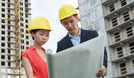 Business team of architects on construction site. Stock Photo