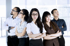 Business team with arms crossed in office Royalty Free Stock Photos