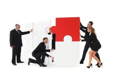 Business team assembling big puzzle Stock Image