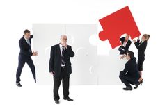 Business team assembling big puzzle Royalty Free Stock Image
