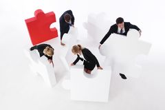 Business team and big puzzle Stock Photo