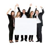 Business team with a banner Royalty Free Stock Image