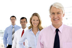 Business Team behind senior leader Stock Photos